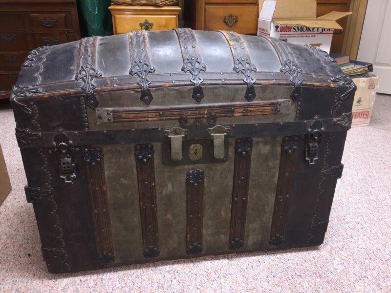 antique trunk: George Burroughscross-slatted, round top antique trunk.