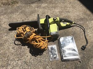 Ryobi chainsaw , chain sharpening kit extra chain, extension cord