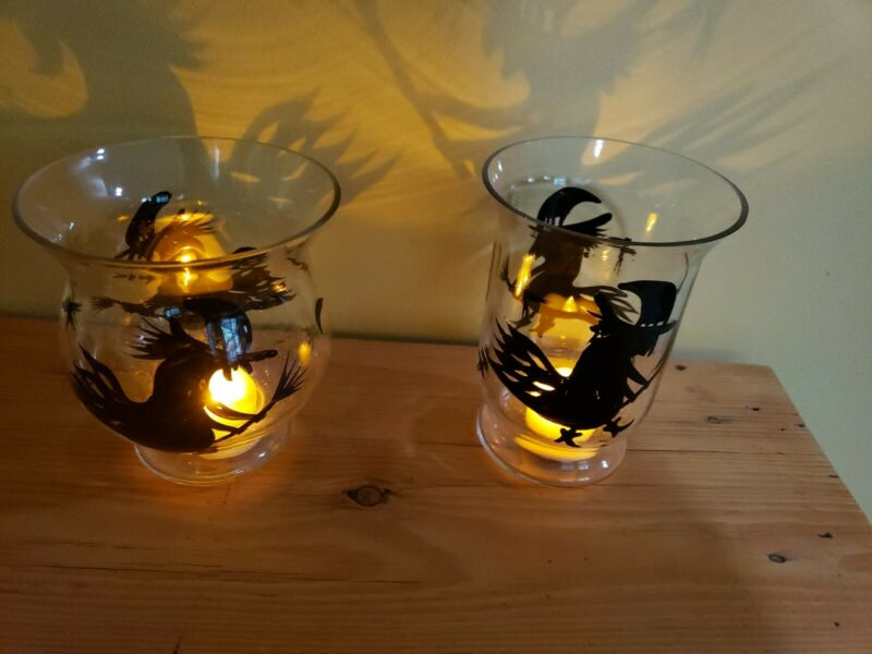 Two GLASS HALLOWEEN WITCH CANDLE HOLDERS