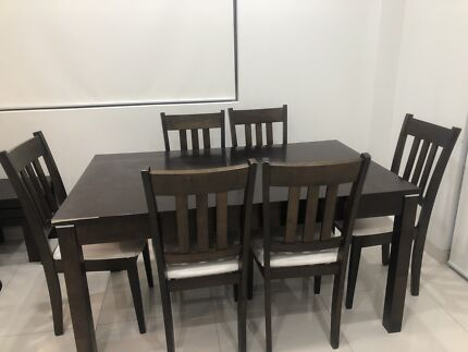 Timber dining table set, with white leather seats.  Six (6) seater