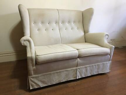 Two seater winged sofa
