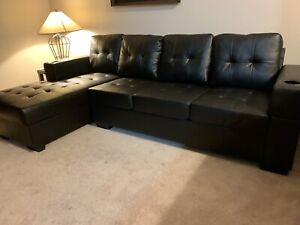 Free delivery: black leather sectional with cupholders