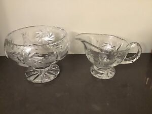 Lead crystal footed bowl and serving pitcher, pinwheel pattern.