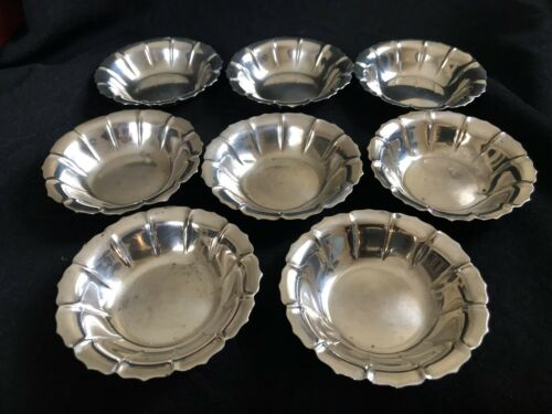 EIGHT ANTIQUE  STERLING SILVER SALT OR NUT DISHES