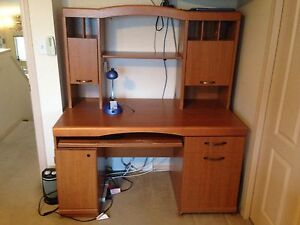 Desk with pull out side table