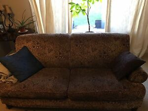 Traditional couch with paisley and nail heads