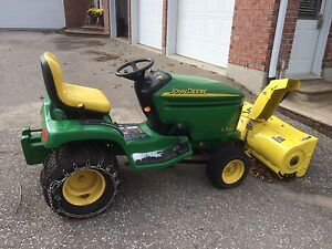 John Deere LX280 tractor with snowblower