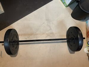 Two 25 lbs (50) weights and lifting bar