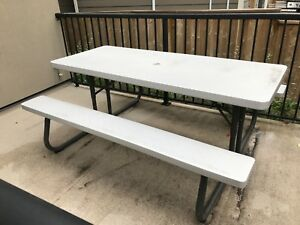 Metal and plastic outdoor picnic style table bench
