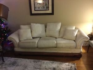 Cream / off white coloured couch and love-seat