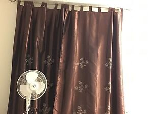 Curtain rods with curtains