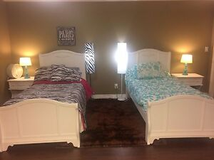 two perfect condition twin beds ,night stands , mattress