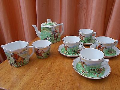 Vintage childs tea  set depicting a hunting scene