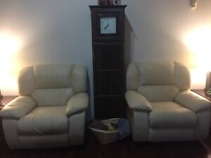 Two beige recliner chairs