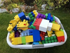 Large bin of mega bocks - includes cars and people.