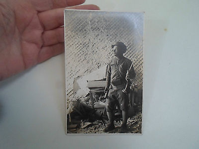 Vintage Real Photo Military Postcard: Man in Building Wreckage (Possibly Soldier