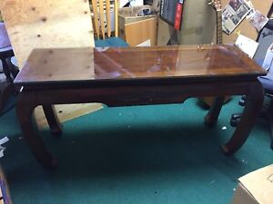 Stained walnut entry table deco with carving