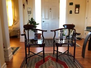 Twin Chinese rosewood corner armchairs