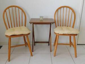 Dining chairs, two spindle backed timber chairs with table