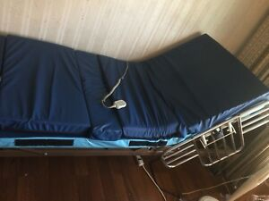 Electric hospital bed.