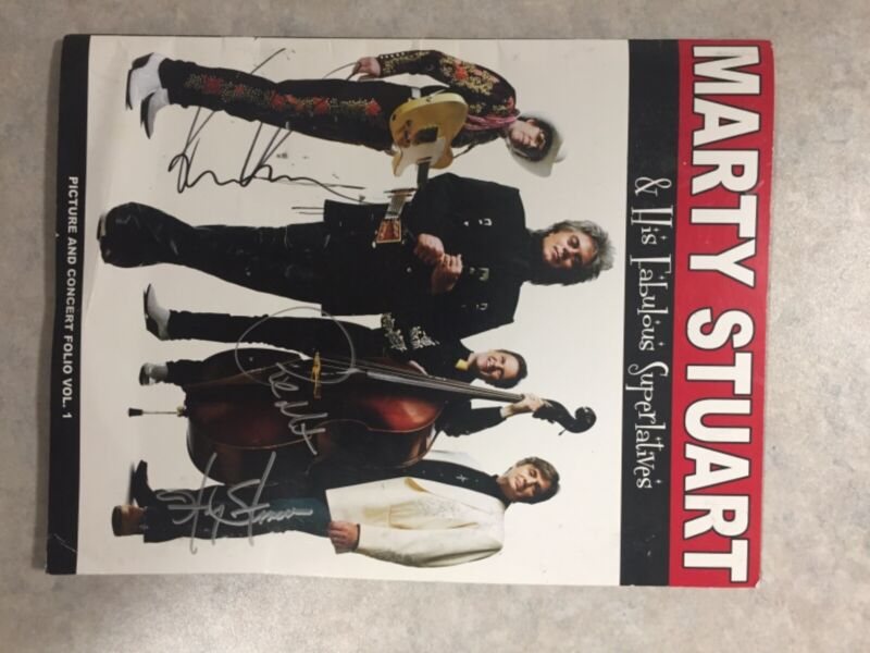 Marty Stuart autographed book of him and his band