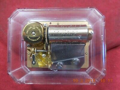 """REUGE ACRYLIC PAPER WEIGHT WITH 1 TUNE 36 NOTE MOVEMENT """"CANON IN D"""""""