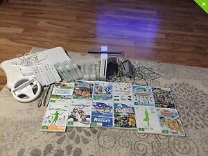Wii console and balance board and games Woodrising Lake Macquarie Area Preview
