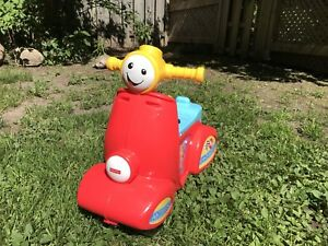 Scooter musical Fisher-Price (trotteur / porteur)