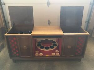 1973 antique stereo cabinet with mini bar.