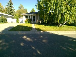 Updated, quiet southside bungalow with garage and mature yard