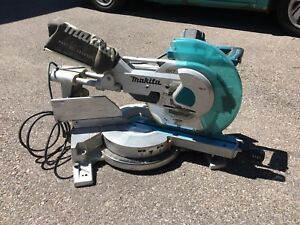 "Makita 12"" Dual Bevel Sliding Mitre Saw and Stand"
