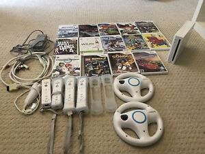 Wii With Controllers, Games, Steering wheels.