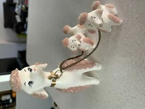 Ceramic poodle and pups figurine
