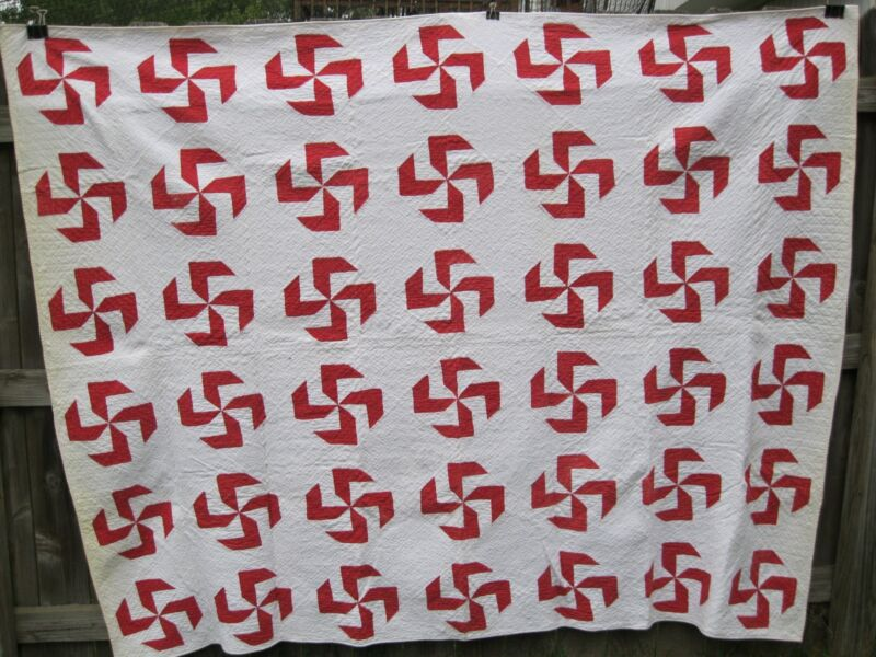 ANTIQUE RED AND WHITE PINWHEEL QUILT