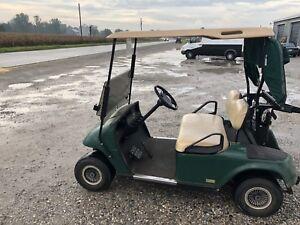 Two ez-go carts