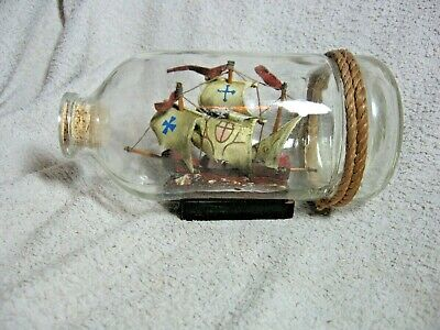 Vintage Ship  In A Glass Bottle on Wooden Plinth ,rope bound.