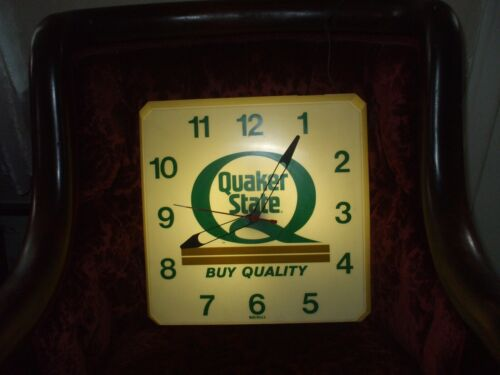 "VINTAGE "" QUAKER STATE   plastic working  clock.16x16 inches"