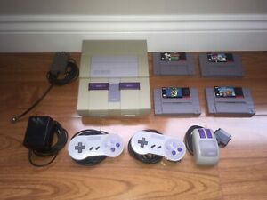 Super Nintendo with 4 games & accessories