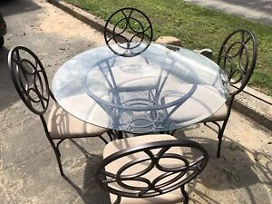 4 chairs and glass dinning table