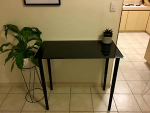 Glass table. Adjustable legs