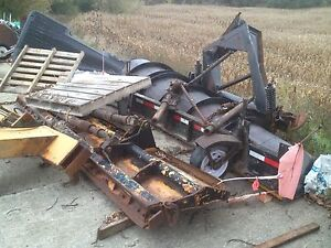 Grader plow, wing and wind row eliminator