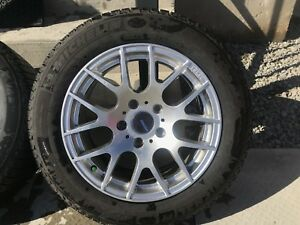 Like new, 205/60R16 Michelin X Ice winter tires with Alloy rims
