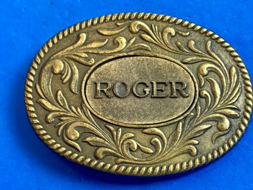 Vintage 1977 western name.  ROGER    flower swirl belt buckle by The Kinney Co.