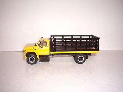 DCP FIRST GEAR 1/64 YELLOW CAB BLACK STAKE SIDE GMC 6500 SINGLE AXLE TRUCK  1