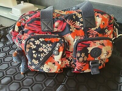 Kipling bags used with monkey