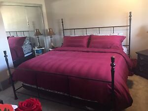 King mattress and wrought iron bed frame
