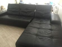 Black leather L shaped lounge Wamberal Gosford Area Preview