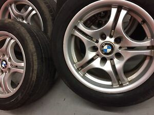 4 Dunlop all season tires with BMW mags:225/50R16