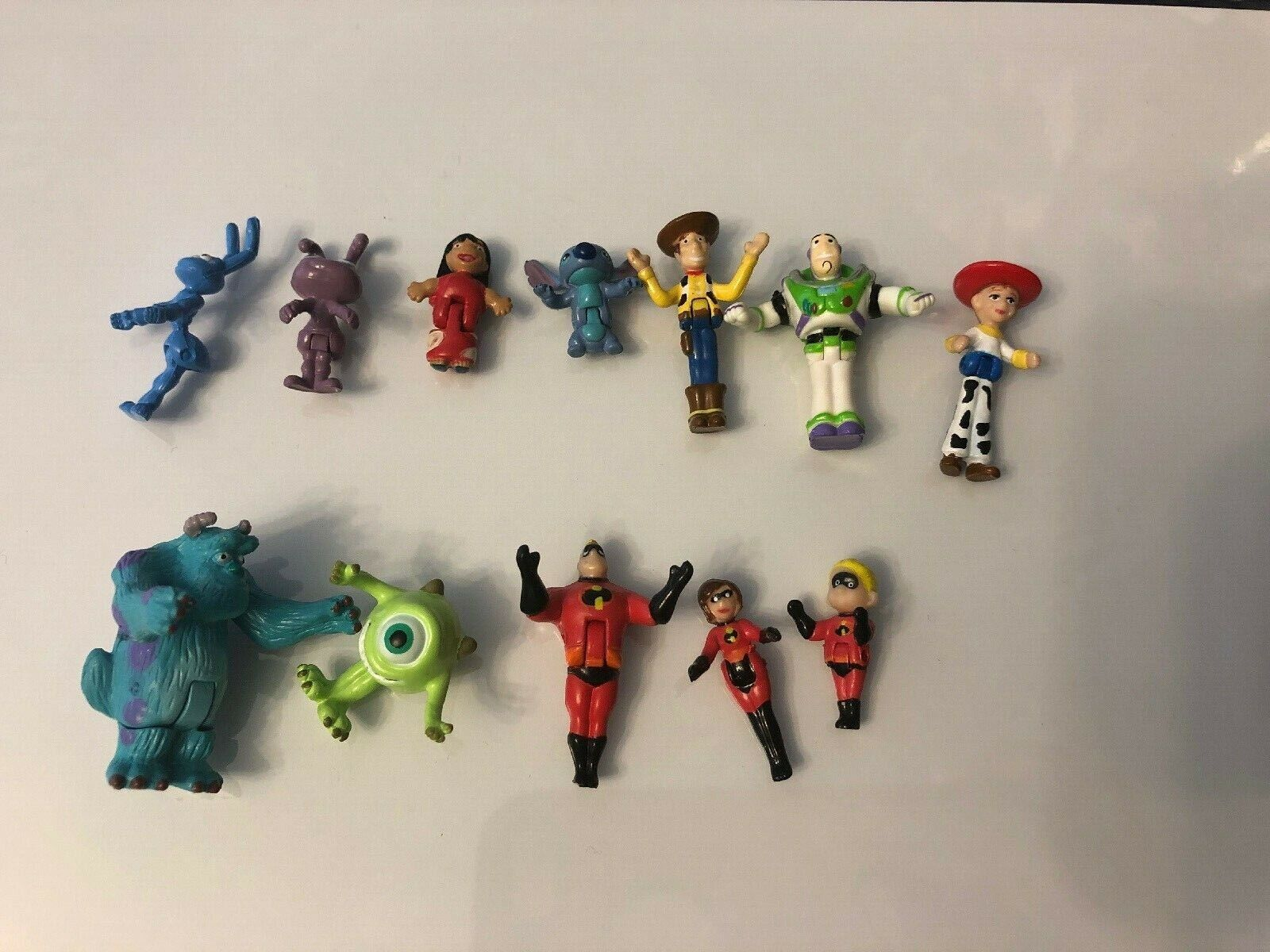 Disney Lot Of 12 Mini PVC Figures Cake Toppers Incredibles/Monsters Inc/Toy Stry - $19.99