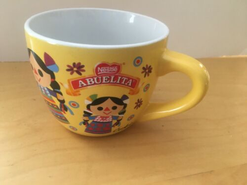 "(2) TWO DIFFERENT NESTLE ABUELITA COFFEE CUPS, 3"", USED"